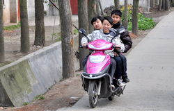 Pengzhou, China: Three Teens on Motorcycle Stock Photo