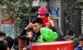 Pengzhou. China: Toddler on Father's Shoulders Royalty Free Stock Image