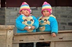 Pengzhou, China: Twin Boys on a Porch Royalty Free Stock Photo