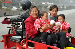 Pengzhou, China: Twins and Family Riding in Motorcycle Cart Stock Photos