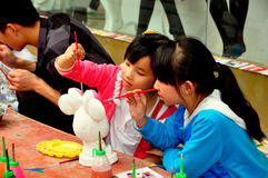 Pengzhou, China: Two Little Girls Painting Royalty Free Stock Images