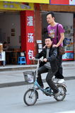 Pengzhou, China: Two Men on a Bicycle Royalty Free Stock Photo