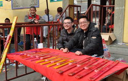 Pengzhou, China: Two Men Selling Incense Stock Photography