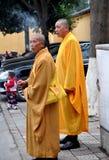 Pengzhou, China: Two Monks on Smoke Break Royalty Free Stock Photo