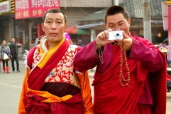 Pengzhou, China: Two Tibetan Monks Royalty Free Stock Photo