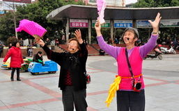 Pengzhou, China: Two Women Dancing & Singing Stock Image