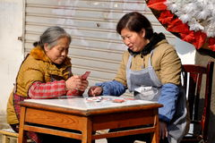 Pengzhou, China: Two Women Playing Cards Royalty Free Stock Images