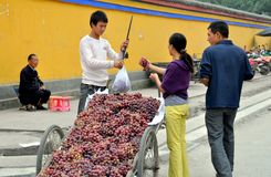 Pengzhou, China: Vendor Selling Grapes Royalty Free Stock Photos