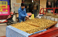 Pengzhou, China: Vendor Selling Longan Fruits Royalty Free Stock Photography