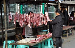 Pengzhou, China: Woman at Butcher Shop Royalty Free Stock Photo