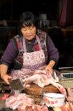 Pengzhou, China: Woman Butchering Chicken Stock Images