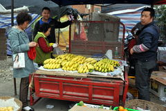 Pengzhou, China: Woman Buying Bananas Stock Photography