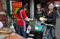Pengzhou, China: Woman Buying Cauliflower Stock Photography
