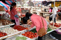 Pengzhou, China: Woman Buying Tomatoes Stock Image