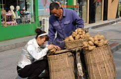 Pengzhou, China: Woman Buying Vegetables Royalty Free Stock Photos
