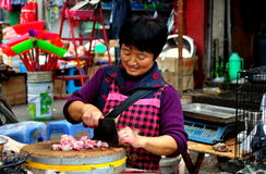 Pengzhou, China: Woman Chopping Fresh Chickens Royalty Free Stock Photo