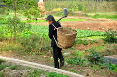 Pengzhou, China: Woman in Field with Shovel and Basket Royalty Free Stock Photos