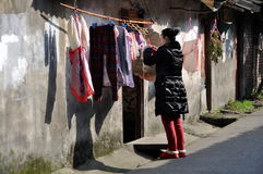 Pengzhou, China: Woman Hanging Laundry Stock Photo