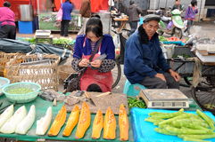 Pengzhou, China: Woman Knitting at Market Stock Photography