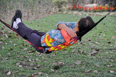 Pengzhou, China: Woman Napping in Hammock Stock Image