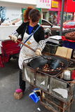 Pengzhou, China: Woman Roasting Chestnuts Stock Photo