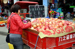 Pengzhou, China:  Woman Selling Apples Stock Image