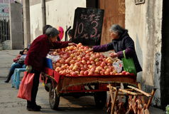 Pengzhou, China: Woman Selling Apples Royalty Free Stock Images