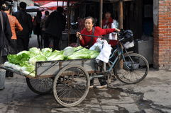 Pengzhou, China: Woman Selling Cabbages Stock Images