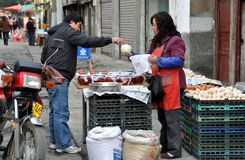 Pengzhou, China: Woman Selling Food Stock Photos