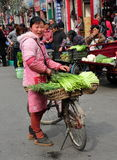 Pengzhou, China: Woman Selling Garlic Royalty Free Stock Images