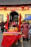 Pengzhou, China: Woman Selling Incense Sticks Stock Photos