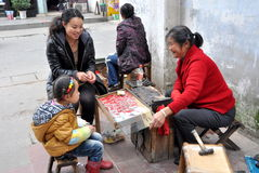 Pengzhou, China: Woman Selling Jewelry Royalty Free Stock Photography