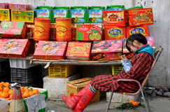 Pengzhou, China: Woman Selling New Year's Fruits Royalty Free Stock Photo
