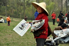 Pengzhou, China: Woman Selling Newspapers Royalty Free Stock Photography