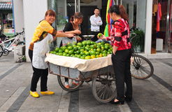 Pengzhou, China: Woman Selling Oranges Royalty Free Stock Photography