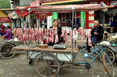 Pengzhou, China: Woman Selling Pork Royalty Free Stock Images
