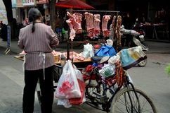 Pengzhou, China: Woman Selling Pork from Bicycle Stock Images