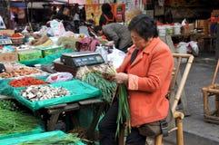 Pengzhou, China: Woman Selling Produce Stock Photo