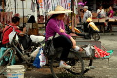 Pengzhou, China: Woman Selling Radishes Royalty Free Stock Photos