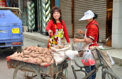 Pengzhou, China: Woman Selling Sweet Potatoes Stock Photography