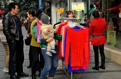 Pengzhou, China: Woman Shopping for Clothes Royalty Free Stock Photography