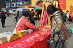 Pengzhou, China: Woman Shopping for Fireworks Stock Images
