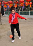 Pengzhou, China: Woman Spinning Ti Huang Top Stock Image