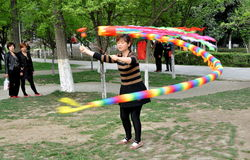 Pengzhou, China: Woman Spinning Top Stock Photos