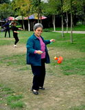 Pengzhou, China: Woman Spinning Top Stock Images
