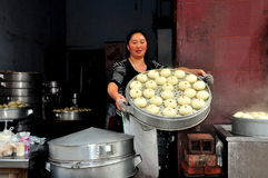 Pengzhou, China: Woman With Steamed Bao Zi Dumplings Stock Photography