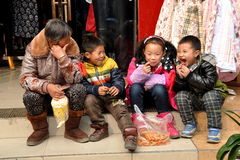 Pengzhou, China: Woman with Three Children Stock Images