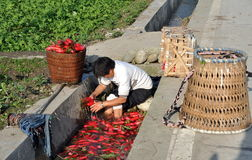 Pengzhou, China: Woman Washing Radishes Stock Photography