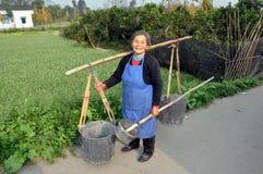 Pengzhou, China:  Woman with Water Buckets Royalty Free Stock Photos