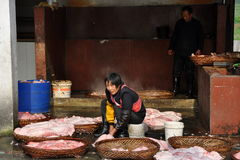 Pengzhou, China: Woman Working in Butcher Shop Royalty Free Stock Images